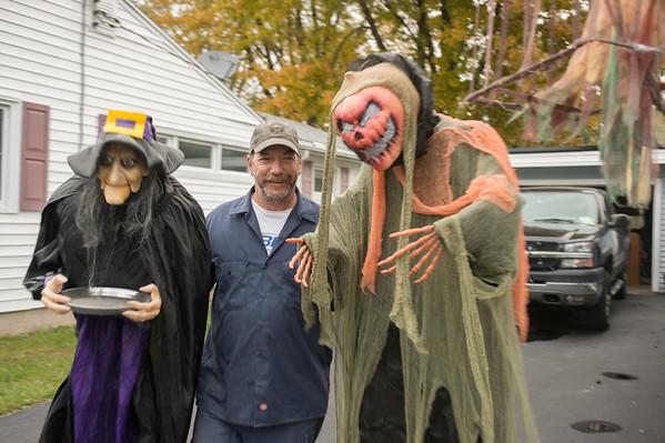 JOED VIERA/STAFF Lockport, NY-Jeff Adams decorates his Cherry Street Lawn for Halloween.
