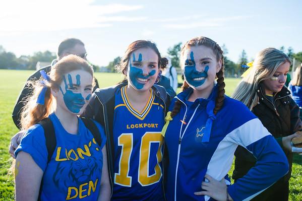 JOED VIERA/STAFF PHOTOGRAPHER-Lockport, NY-Lockport High School students Stephenie Long, Chloe Hopcia and Emma McKenna wait to watch a faculty football game.