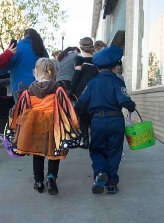 JOED VIERA/STAFF Lockport, NY-John Grucza 3(Cop) and Addison Fox 3 (Butterfly) walk hand in hand during Downtown's Trick or Treating.
