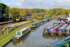 20 October 2015 :: The delightful view of the boat yard adjacent to Heyford Station as a Cross Country voyager passes on 1E44, the 1146 from Southampton to Newcastle