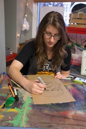 JOED VIERA/STAFF PHOTOGRAPHER-Lockport, NY-Elyssa Harper draws a zombie storm trooper at pulp 716. Harper is the shop's artist of the week.