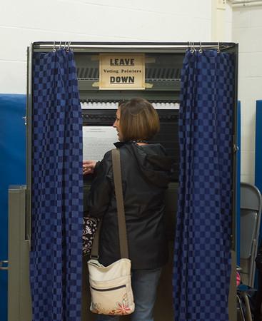 JOED VIERA/STAFF Newfane, NY-Brenda Lekanka casts her vote at Newfane Elementary School.