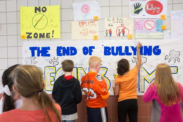 JOED VIERA/STAFF Lockport, NY-Emett Belknap students sign a Anti-Bullying poster at the school.