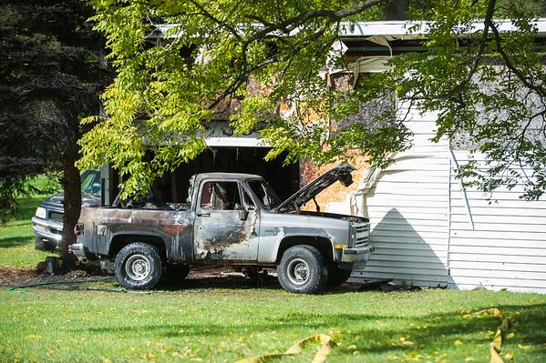JOED VIERA/STAFF PHOTOGRAPHER-Gasport, NY- A fire damaged a vehicle and a garage on Ridge Road.