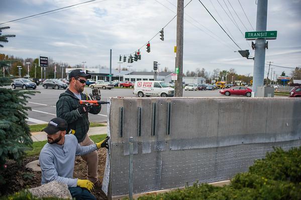 JOED VIERA/STAFF PHOTOGRAPHER-Lockport, NY-Joe Hylkema and Austin Gailor install the stonework for new signs