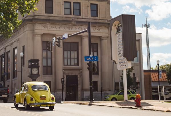 JOED VIERA/STAFF PHOTOGRAPHER-Lockport, NY-An old Volkswagon Beetle  passes the Niagara County National Bank Building.