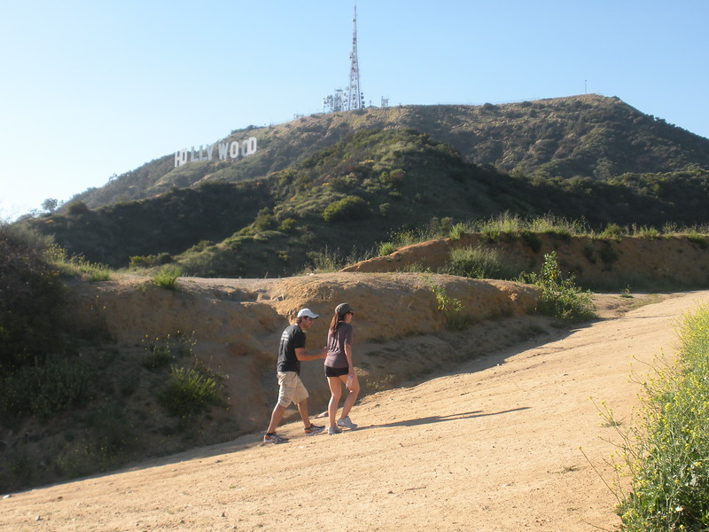 Visitors Hiking Toward the Hollywood Sign in California