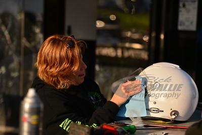 Gail Gruendler readies Scott Bloomquist's helmet