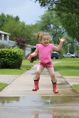 Saleena jumping in a puddle.