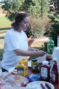 Nikole Rampy, secretary of Sigma Zeta, enjoys the cookout with her fellow students.