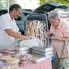 JOED VIERA/STAFF PHOTOGRAPHER-Newfane, NY-Pearl Dixon buys Italian bread from Eddy Thompson at<br /> E. Antonio's Bakery during Newfane's Farmers Market