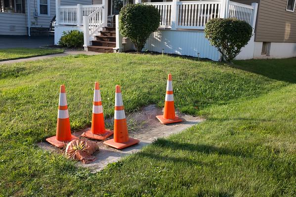 JOED VIERA/STAFF PHOTOGRAPHER-Lockport, NY-Cones mark the sinkhole on the Walnut Street home's lawn.