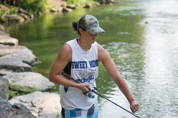 JOED VIERA/STAFF PHOTOGRAPHER-Burt, NY-Devin Gonzales from Tonawanda adjusts her rod at Fishermans Park