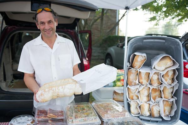 JOED VIERA/STAFF PHOTOGRAPHER-Newfane, NY- Eddy Thompson shows of some of his Italian Bread at E. Antonio's Bakery during Newfane's Farmers Market