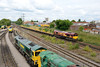 4 September 2015 :: 66050 is passing the Freightliner depot at Maritime working 6O41 from Westbury to Eastleigh