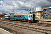 1 September 2015 :: Arriva Trains 153362 is pictured at Cardiff with a backdrop of an old water tower and the Millennium Stadium