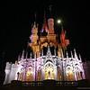 The Moon Glows Behind Cinderella Castle at Walt Disney World