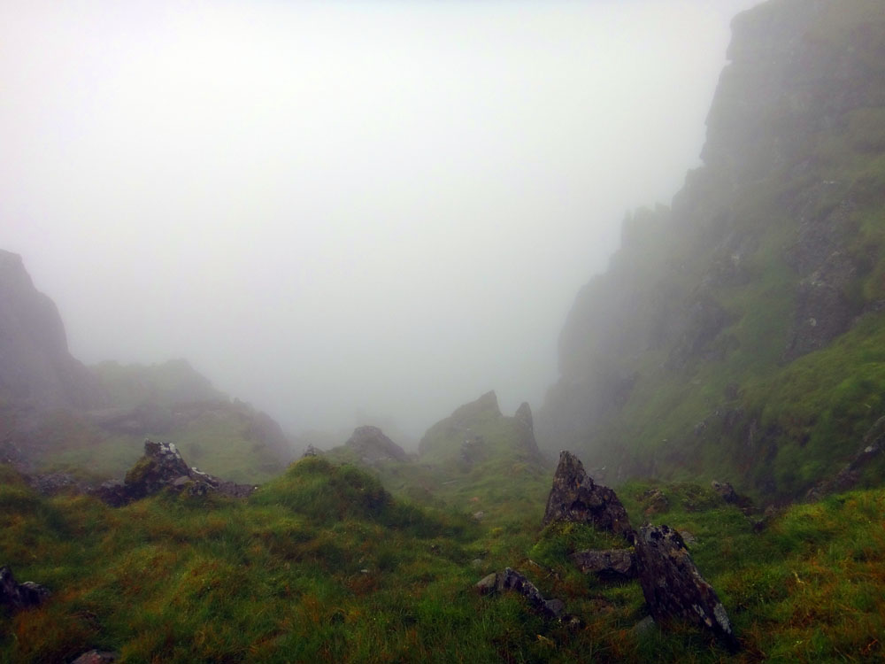 Scary drops into the clouds near the summit