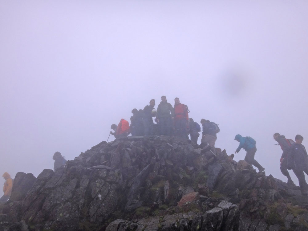 Finally, we made the summit at 1,085 m, where our attempt to light candles for the birthday cake I smuggled up for Jasmijn, and to have about 300 of us up there at once, was thwarted by freezing sleet and high winds. Welsh summers...!