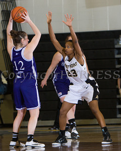 Holy Cross Guard Lisa Mifsud (12) handles the ball as Daizjah Morris (23) defends. The Army Black Knight's defeated the Holy Cross Crusaders 67-53 at the United States Military Academy's Christl Arena in West Point, NY on Wednesday, January 14, 2015. Hudson Valley Press/CHUCK STEWART, JR.