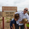 #1 - A Funny Sign<br /> Dad is busy controlling the children... all three in a headlock!