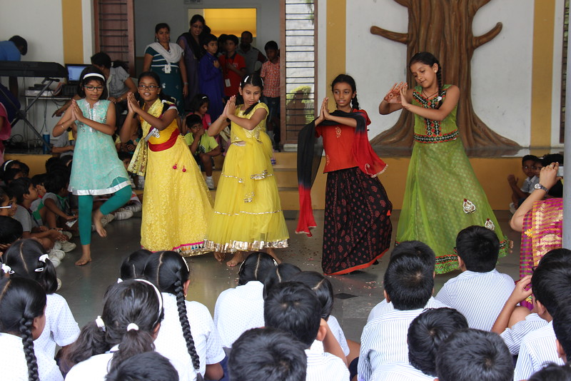 Primary students presenting a dance for their teachers.