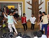 Class V students presenting a dance for their teachers.