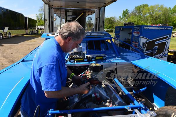 Brandon Sheppard crew member works under the hood