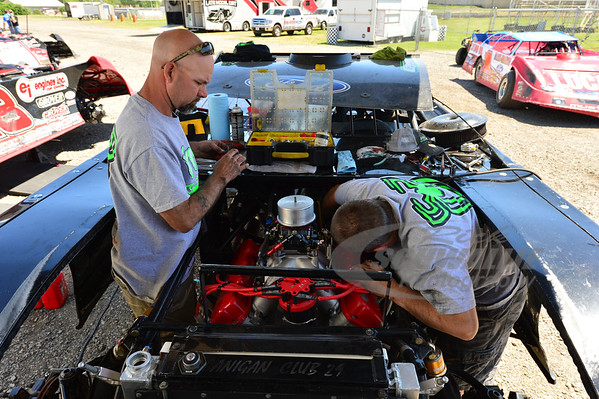 Jimmy Owens crew members work under the hood