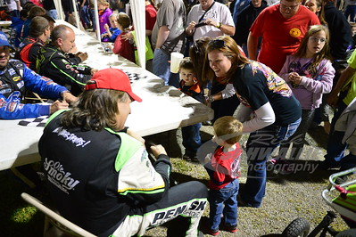 Scott Bloomquist signs an autograph for a young fan