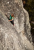 Tracy climbs the flaring dihedral crack of <i>Battle of the Bulge 5.8R</i> on Puppy Dome in Tuolumne.