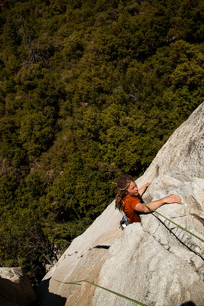 Noah works the moves on <i>Moby Dick 5.10</i> at the base of El Capitan.