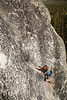 Ezra climbs the flaring dihedral crack of <i>Battle of the Bulge 5.8R</i> on Puppy Dome in Tuolumne.