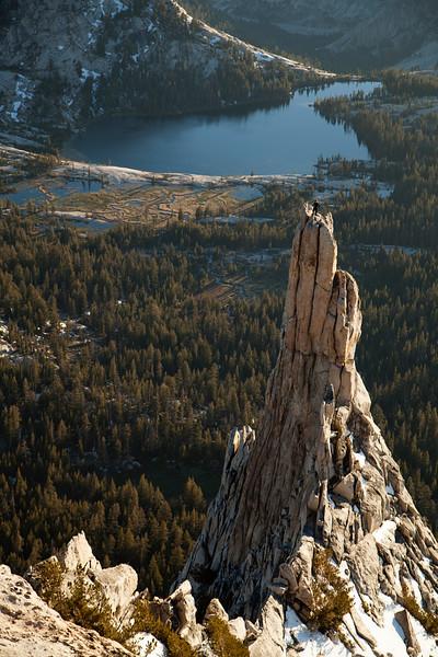 A fellow climber stands proud atop Eichorn Pinnacle.