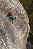 Noah climbs the flaring dihedral crack of <i>Battle of the Bulge 5.8R</i> on Puppy Dome in Tuolumne.