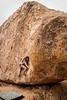 Noah works the moves on <i>Monkey Dihedral V2</i> on the Saigon Boulder.