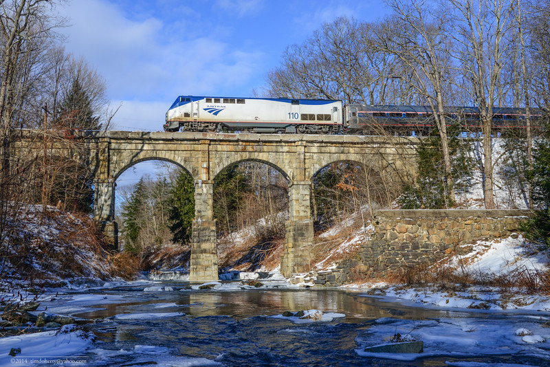 The Vermonter crosses the Falls River on Conn River Line in Massachusetts.