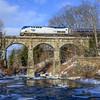 The Vermonter crosses the Falls River on Conn River Line in Massachusetts.