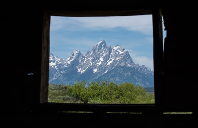 Tetons from inside the Cunningham Cabin.