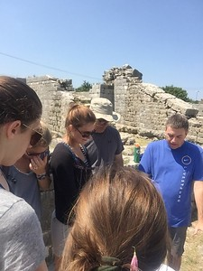 """Ken Janke, our guide, prayed for the """"things we wanted to leave behind"""" in the arena at Salona. A powerful moment."""