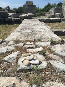 """Our """"burdens""""- we all write down things we want to leave behind on rocks we took from the beach at Omiš. We prayed together and then we made a cairn out of them in a corner of the arena."""