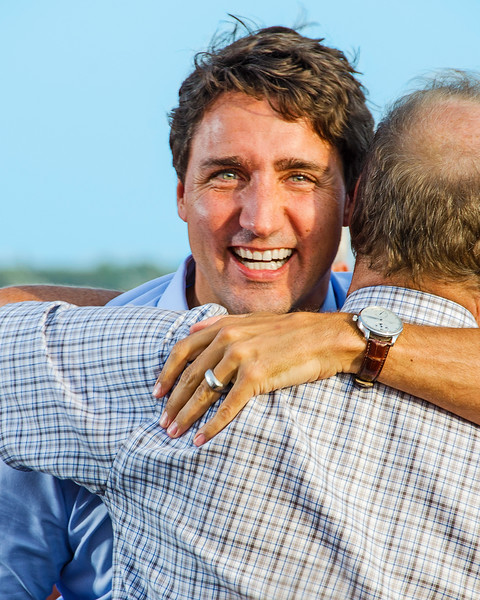 Justin Trudeau hugging Liberal MP Lawrence MacAulay at Summerside, Prince Edward Island. 7 September, 2015.