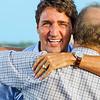 Justin Trudeau hugging Liberal MP Lawrence MacAulay at Summerside, Prince Edward Island. 7 September, 2015.
