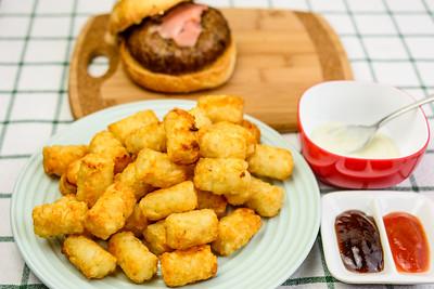 Beef burger with potato gems, wasabi aioli, barbecue sauce and tomato sauce