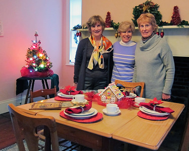 Sarah Stransky, Gretchen Prater and Susan Straten decorate the kitchen at Israel Crane House & Historic YWCA