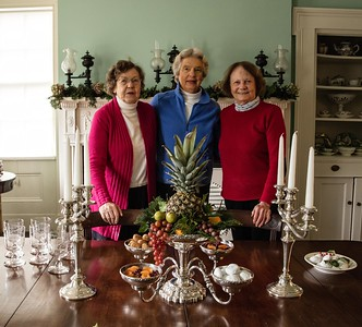 Betty Ann Cannell, Aubin Ames and Fritzi Mills decorate the Crane House dining room.