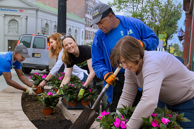 Garden Club of Montclair members Anne Stusnick,Luce Battsek and Fran Ackerly  work with  Montclair Business Improvement District employees Dylan Blackwell and  Richard Capers to plant annuals in Church Street flower beds.