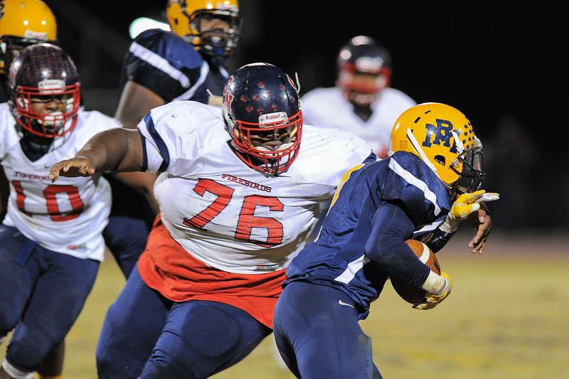 Southern Nash Tim Batchelor (76) and Rocky Mount Bj Sanders (1) Rocky Mount defeats Southern Nash 35-14 Friday evening October 30, 2015 in Rocky Mount, NC (Photos by Anthony Barham / WRAL contributor.)