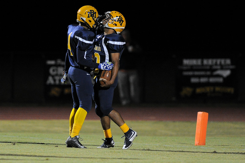 Rocky Mount Jaclayton Freeman (4) and Rocky Mount Tyrell Forbes (30) Rocky Mount defeats Southern Nash 35-14 Friday evening October 30, 2015 in Rocky Mount, NC (Photos by Anthony Barham / WRAL contributor.)