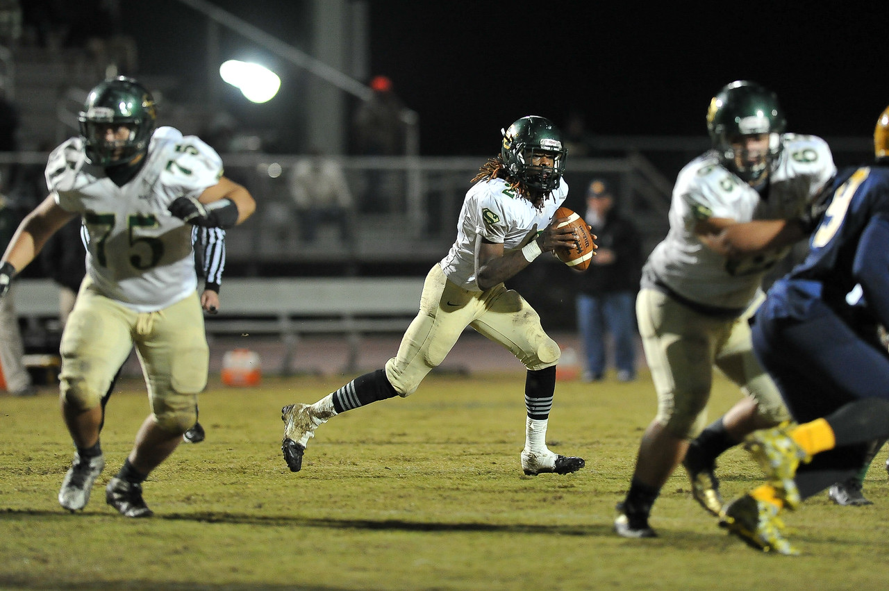 South Johnston Jac'quel Walker (2)  drops back to pass during tonights game. Rocky Mount defeats South Johnston in the 2nd round of the playoffs 34-20 Friday evening November 20, 2015 in Rocky Mount NC (Photos by Anthony Barham / WRAL contributor.)